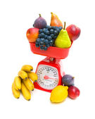 Kitchen scales and fruits isolated on white background close-up. — Stock Photo