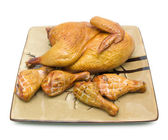 Smoked chicken on a plate on white background — Stock Photo