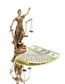 Statue of justice and money on white background. — Stock Photo