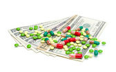 Money and medical drugs on white background — Stock Photo