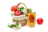 Apples, a glass of juice and apple flowers on a white background — Photo