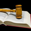 Judges gavel and law book on a black background — Stock Photo #46463827