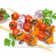Skewers of meat with vegetables isolated on a white background — Stock Photo #47425805