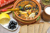 Russian thistle soup and other food on a wooden background — Stock Photo