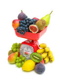 Fresh fruit and kitchen scale on white background. — Stock Photo