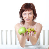 Beautiful young woman with fruit — Stock Photo
