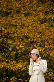 Attractive woman in evening autumn park — Stock Photo