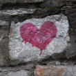 Red heart on old stone wall — Stock Photo #19142077