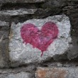 Red heart on old stone wall - Stock Photo