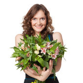 Portrait of pretty brunette holding bouquet of flowers — Stock Photo