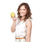 Portrait of an attractive young woman with an apple — Stock Photo