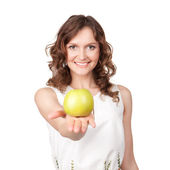Portrait of young girl which gives of a green apple — Stock Photo