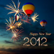 New year 2012 fireworks and hot air-balloon at sunset — Stock Photo #7619523