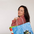 Adult woman with christmas shopping bags — Stockfoto