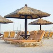 Chaise lounge on a beach in Dubai — Stock Photo