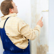 Man painting wall with roller — Stock Photo