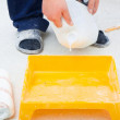 Worker pouring paint from a large bucket — Stock Photo
