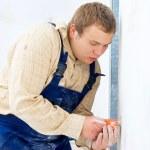 Workman installing power socket — Stock Photo
