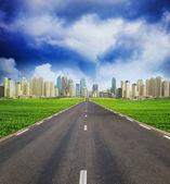 Green field and Dubai Town City on Horizont — Stock Photo