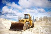 Construction tractor in Dubai Palm island Beach — Stock Photo