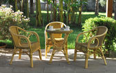 Wicker chairs and table — Stock Photo