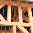 Wood frame of house under construction — Stock Photo #13686131
