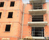 Residential building under construction in red brick — Foto de Stock