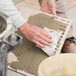 A tiler laying a tiled marble — Stock Photo #25583151