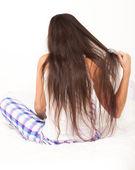 Woman brush her long hair — Stock Photo