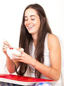 Woman drinking bowl at breakfast — Stock Photo