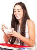 Woman drinking bowl at breakfast — Stock Photo