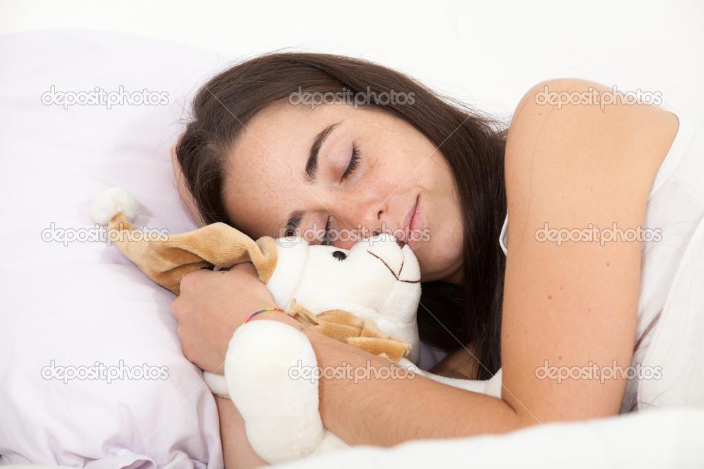 femme dormir avec un ours en peluche photographie chretien 38225177. Black Bedroom Furniture Sets. Home Design Ideas
