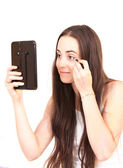 Mujer aplicar maquillaje — Foto de Stock