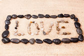 Word love written with pebbles on the sand of a beach — Stock Photo