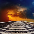 Stock Photo: Railroad goes to dramatic sunset