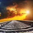 Dramatic sunset over railroad - Stockfoto