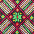 Stock Photo: Embroidered good by cross-stitch pattern