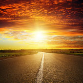 Red sunset over road — Foto Stock