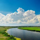 Clouds over river — Stockfoto