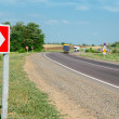 Turn right sign, curved road and blue sky — Stockfoto