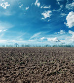Plowed field under dramatic sky — Stock Photo