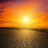 Red sunset over road — Stock Photo