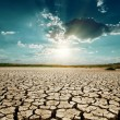Stock Photo: Dramatic sunset over drought land