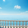 Balcony near sea under blue sky - Stock Photo
