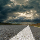 Dramatic sky over asphalt road — Stock Photo
