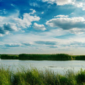 Dramatic sky with clouds over river — Stock Photo