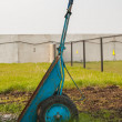 Wheelbarrow on green grass - Stock Photo