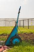 Wheelbarrow on green grass — Stock Photo