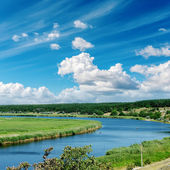 River and cloudy sky over it — Stock Photo
