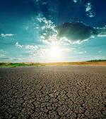 Drought land and dramatic sunset — Stock Photo